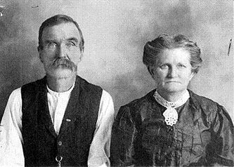 The real James L. Courtney and his wife, Susan Eubanks